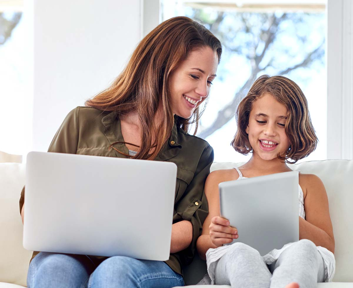 A mother and daughter checking their MeMail email accounts.